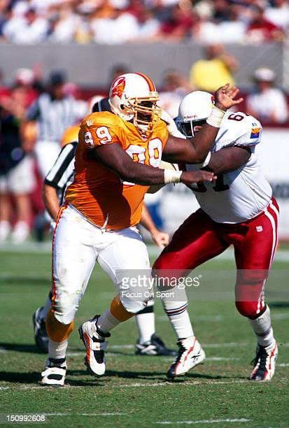 Warren Sapp of the Tampa Bay Buccaneers rushes and is blocked by Duval Love of the Arizona Cardinals during an NFL football game at Sun Devil Stadium...
