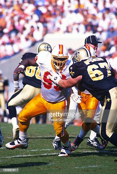 Warren Sapp of the Tampa Bay Buccaneers rushes up against Andy McCollum of the New Orleans Saints during an NFL football game at Tampa Stadium...
