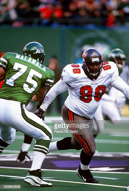 Warren Sapp of the Tampa Bay Buccaneers rushes up against Siupeli Malamala of the New York Jets during an NFL football game at The Meadowlands...