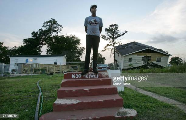 Warren Schexnader stands on the steps of his old home in front of another destroyed home and the FEMA trailer he is currently living in June 8 2007...