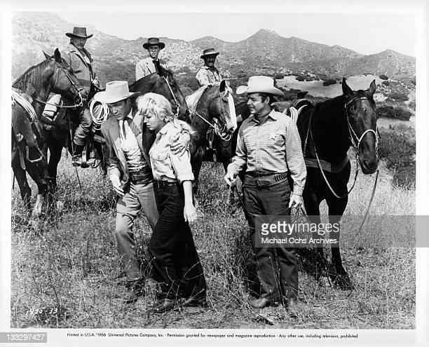 Warren Stevens helps Joan Staley to her horse in a scene from the film 'Gunpoint' 1966