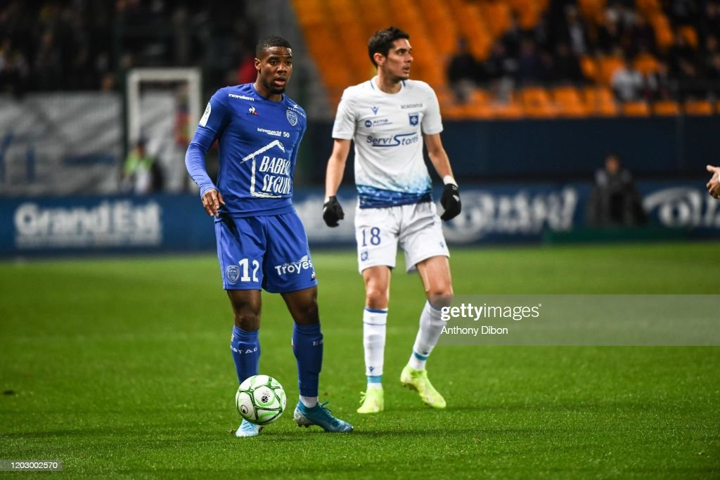 Warren Tchimbembe Of Troyes And Francois Bellugou Of Auxerre During News Photo Getty Images