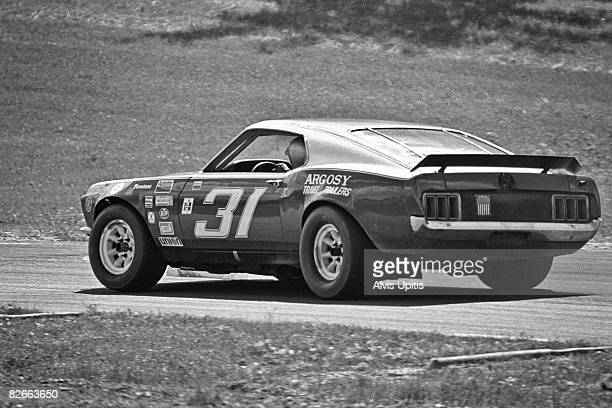 Warren Tope's Ford Mustang in route to winning the Trans Am race held July 15 1972 on the Road America Course at Elkhart Lake Wisconsin
