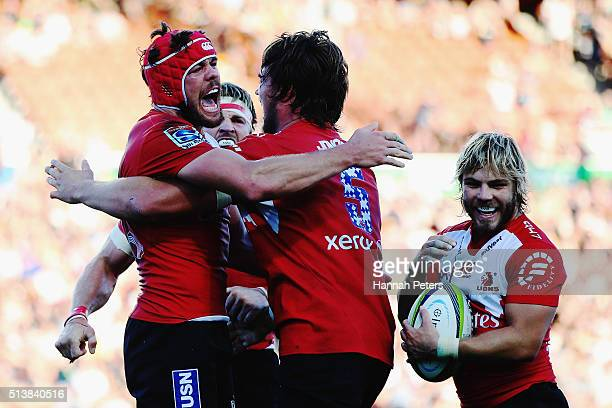 Warren Whiteley of the Lions celebrates with Franco Mostert of the Lions after winning the round two Super Rugby match between the Chiefs and the...