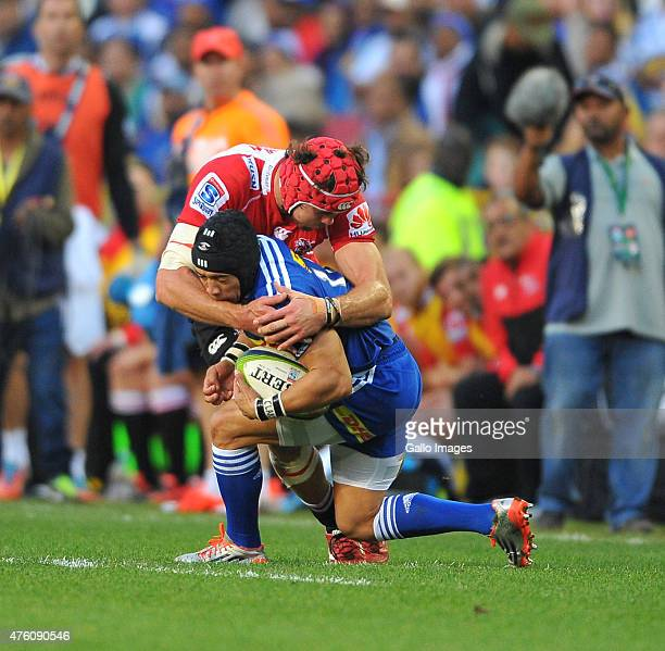 Warren Whiteley of the Lions tackles Cheslin Kolbe of the Stormers during the Super Rugby match between DHL Stormers and Emirates Lions at DHL...