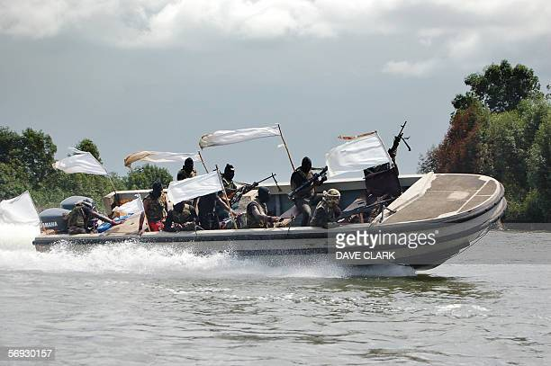 Nigerian separatist militants wheel round their war boat 24 February 2006 on the Escravos River in southern Nigeria The selfstyled Movement for the...