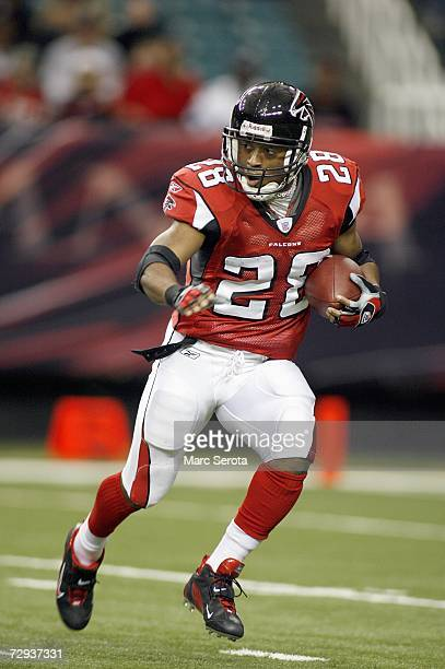 Warrick Dunn of the Atlanta Falcons carries the ball during a game against the Carolina Panthers on December 24 2006 at The Georgia Dome in Atlanta...