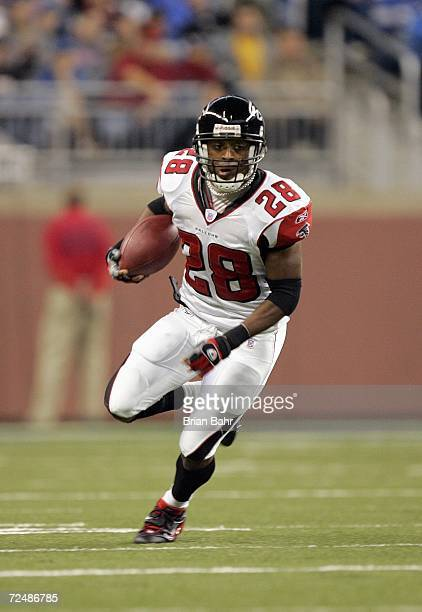 Warrick Dunn of the Atlanta Falcons carries the ball during the game against the Detroit Lions on November 5 2006 at Ford Field in Detroit Michigan...