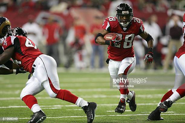 Warrick Dunn of the Atlanta Falcons runs 19yards for his second touchdown against the St Louis Rams during second quarter the NFC Divisional Playoff...