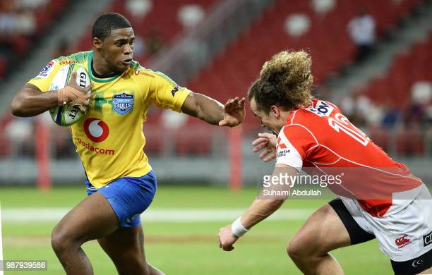 Warrick Gelant of Bulls fends off a challenge from Michael Little of Sunwolves during the Super Rugby match between Sunwolves and Bulls at the...