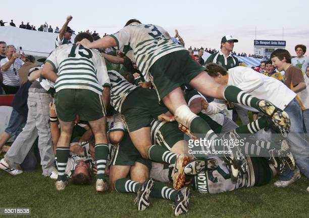 Warringah players and fans celebrate the match sealing try at full time during the Shute Shield Final between Warringah and Sydney University at...