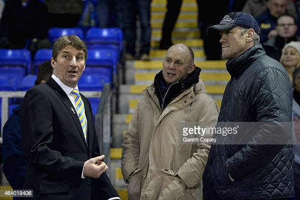 Warrington coach Tony Smith speaks with fellow coaches Tony Rea and Brian McDermott ahead of the World Club Series match between Warrington Wolves...