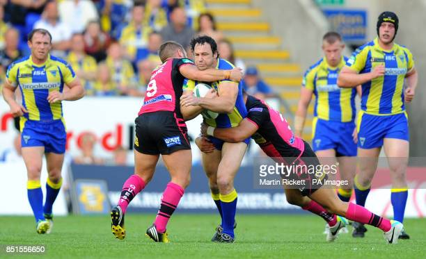 Warrington Wolves' Adrian Morley is tackled by Leeds Rhinos Paul McShane and Alex Foster during the Super League match at the Halliwell Jones Stadium...
