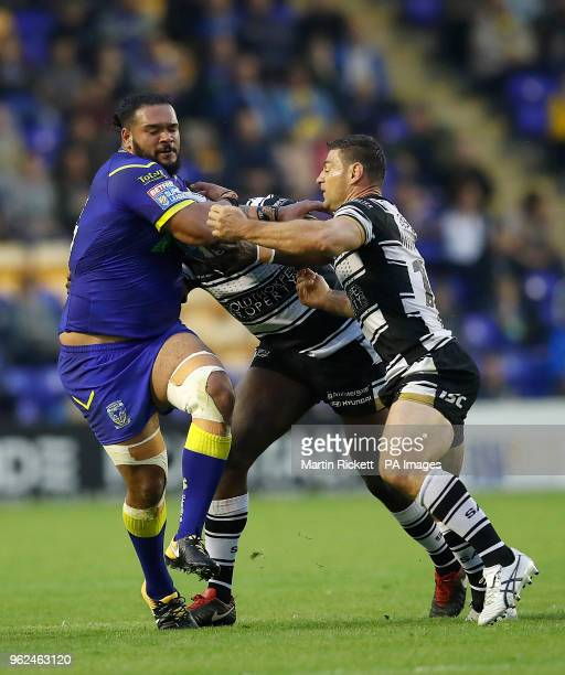 Warrington Wolves' Ben MurdockMasila is tackled by Hull FC's Masimbaashe Matongo and Mark Minichiello during the Betfred Super League match at the...
