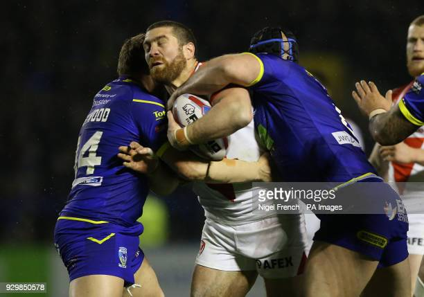 Warrington Wolves Ben Westwood and Chris Hill tackle St Helens Kyle Amor during the Betfred Super League match at The Halliwell Jones Stadium...