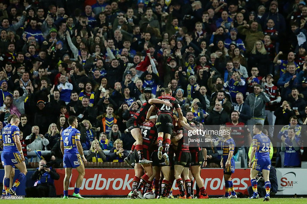 Warrington Wolves celebrate after Chris Sandow scores the opening try of the First Utility Super League opening match between Leeds Rhinos and Warrington Wolves at Headingley Carnegie Stadium on February 4, 2016 in Leeds, England.