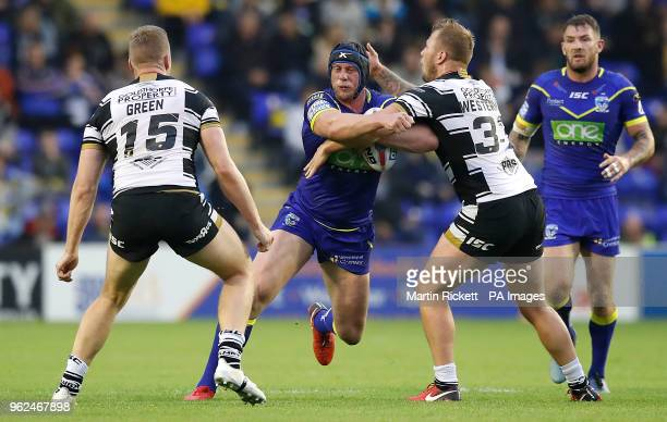 Warrington Wolves' Chris Hill is tackled by Hull FC's Chris Green and Joe Westerman during the Betfred Super League match at the Halliwell Jones...