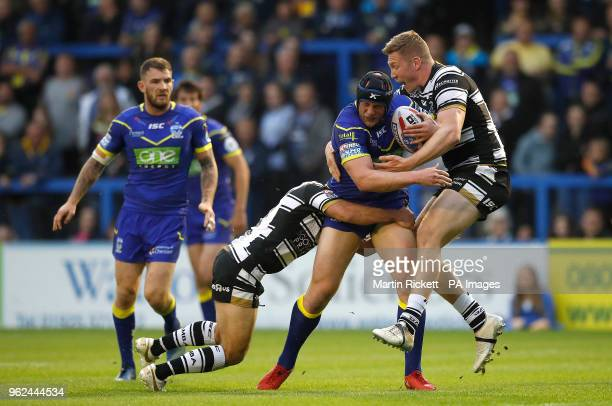 Warrington Wolves' Chris Hill is tackled by Hull FC's Danny Houghton and Chris Green during the Betfred Super League match at the Halliwell Jones...