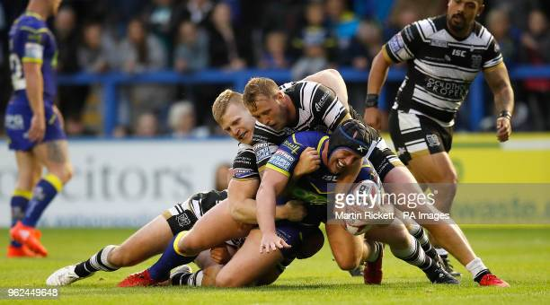 Warrington Wolves' Chris Hill is tackled by Hull FC's Danny Houghton Brad Fash and Joe Westerman during the Betfred Super League match at the...