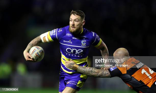 Warrington Wolves' Daryl Clark is tackled by Castleford Tigers' Nathan Massey during the Betfred Super League match at Halliwell Jones Stadium...