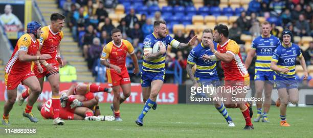 Warrington Wolves' Daryl Clark is tackled by Catalans Dragons' Benjamin Garcia during the Betfred Super League Round 17 match between Warrington...