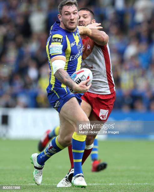 Warrington Wolves' Daryl Clark is tackled by Catalans Dragons' Jason Baitieri during the Betfred Super League match at the Halliwell Jones Stadium...