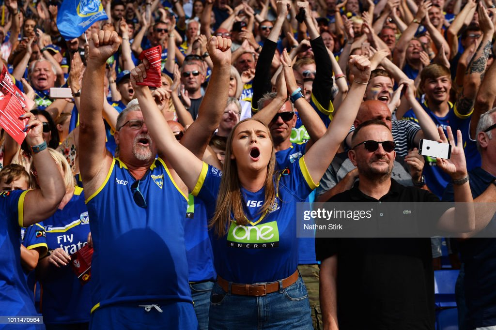 A Warrington Wolves fan during the Ladbrokes Challenge Cup Semi Final match between Warrington Wolves and Leeds Rhinos at Macron Stadium on August 5, 2018 in Bolton, England.