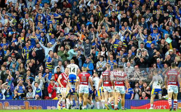 Warrington Wolves fans celebrate Blake Austin's try during the Dacia Magic Weekend Round 16 match between Wigan Warriors and Warrington Wolves at...
