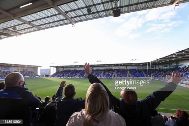 Warrington Wolves fans welcome their team on to the pitch prior to the Betfred Super League match between Warrington Wolves and Huddersfield Giants...