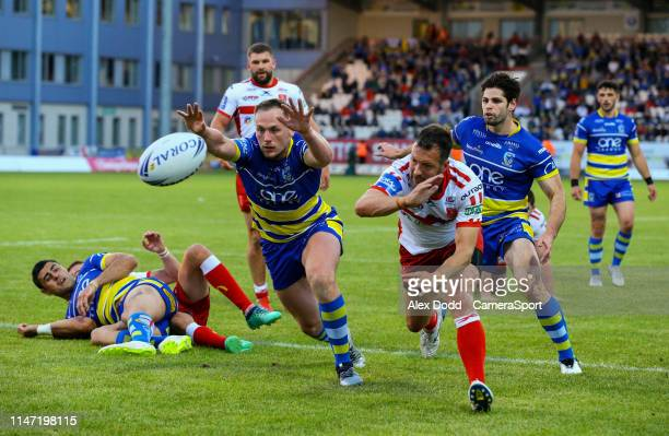 Warrington Wolves' Jason Clark and Hull Kingston Rovers' Danny McGuire try to reach a ball during the Coral Challenge Cup Quarter-Final match between...