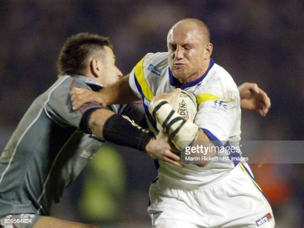Warrington Wolves Mark Hilton is tackled by Widnes Vikings Julian O'Neill.