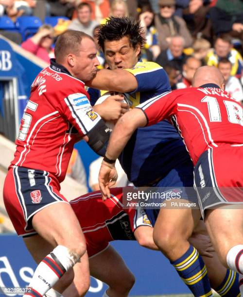 Warrington Wolves' Paul Rauhihi is tackled by Hull KR's Jim Gannon and Danny Ward during the Carnegie Challenge Cup fourth round match at Halliwell...