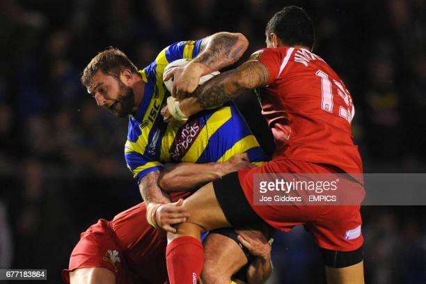 Warrington Wolves' Paul Wood and Celtic Crusaders' Frank Winterstein in action