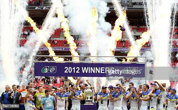 Warrington Wolves players celebrate with the trophy during the Carnegie Challenge Cup Final between Leeds Rhinos and Warrington Wolves at Wembley...