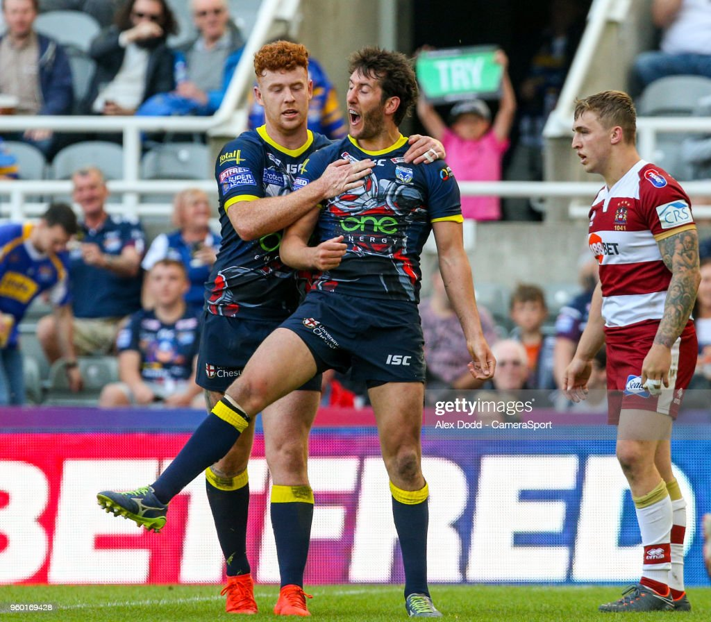 Warrington Wolves' Stefan Ratchford celebrates scoring his side's second try with Harvey Livett during the Betfred Super League Round 15 match between Wigan Warriors and Warrington Wolves at St James' Park on May 19, 2018 in Newcastle upon Tyne, England.
