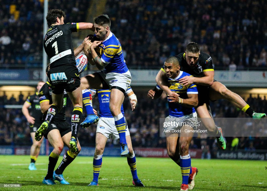 Warrington Wolves' Stefan Ratchford competes in the air with Leeds Rhinos' Joel Moon during the Betfred Super League Round 14 match between Leeds Rhinos and Warrington Wolves at Headingley Carnegie Stadium on May 4, 2018 in Leeds, England.