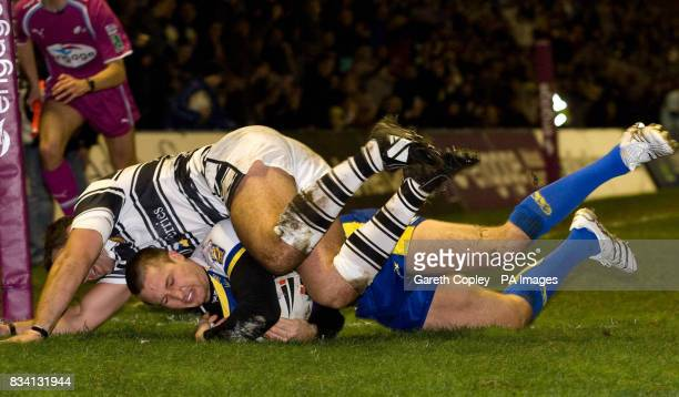 Warrington's Chris Hicks scores past Hull FC's Todd Byrne during the Engage Super League match at the Halliwell Jones Stadium Warrington