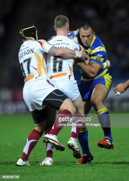Warrington's Louis Anderson is tackled by Huddersfield's Dale Ferguson and Kevin Brown during the engage Super League match at the Galpharm Stadium...