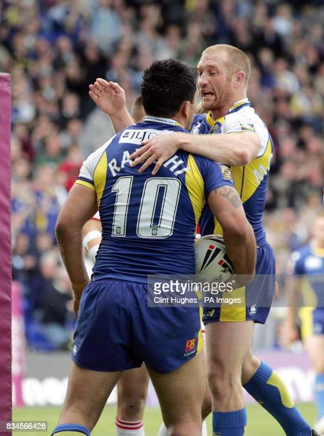 Warrington's Paul Rauhihi celebrates with teammate Michael Monaghan after he scores the fourth try during the engage Super League match at the...