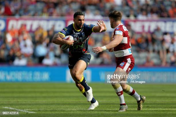 Warrington's Ryan Atkins holds off Wigan warriors Oliver Gildart during the Betfred Super League Magic Weekend match at St James' Park Newcastle