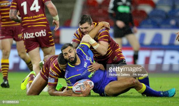 Warrington's Ryan Atkins is tackled by Huddersfield Giants Danny Brough and Kruise Leeming during the Betfred Super League match at the Kirklees...