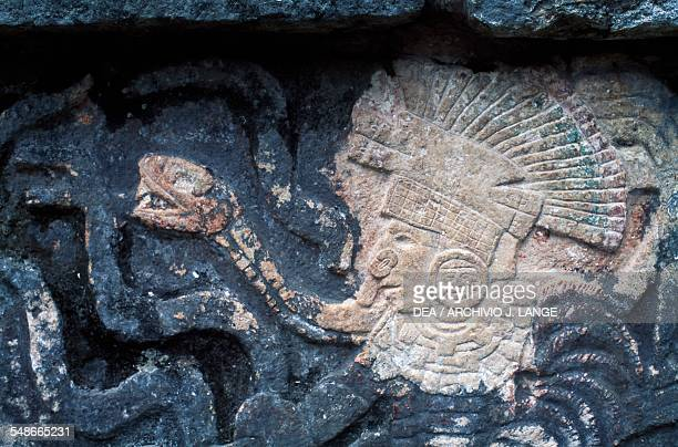 Warrior and snakes relief on the wall of the Tzompantli Chichen Itza Yucatan Mexico Mayan civilisation 10th13th century