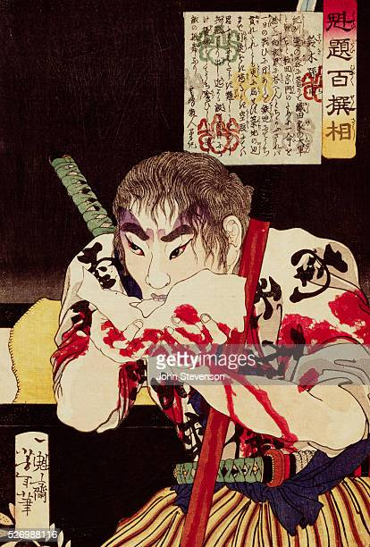 A warrior called Suzuki Magoichi eats a riceball at the end of a day of battle His hands are red from blood that has flowed down his spear His gaze...