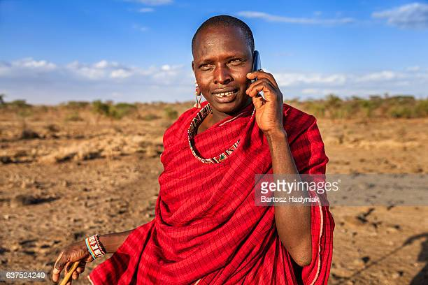 warrior from maasai tribe using mobile phone, kenya, africa - east africa stock photos and pictures
