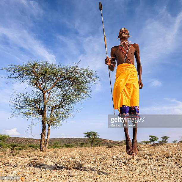 warrior from samburu tribe performing traditional jumping dance, kenya, africa - masai fotografías e imágenes de stock