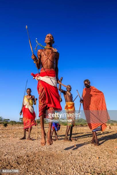 Warrior from Samburu tribe performing traditional jumping dance, Kenya, Africa