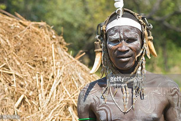 warrior from the mursi tribe in southern ethiopia - mursi tribe stock pictures, royalty-free photos & images