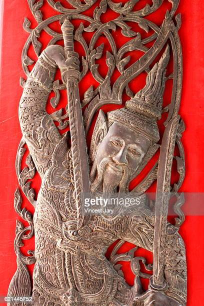 Warrior guard woodcut carving Bangkok Thailand