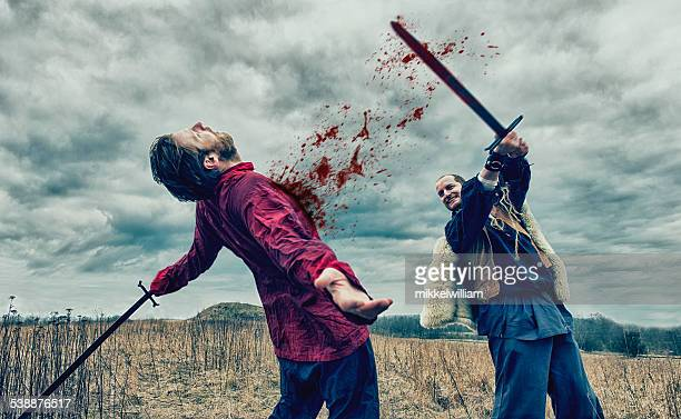 warrior kills opponent with sword on a battlefield - battlefield stock pictures, royalty-free photos & images