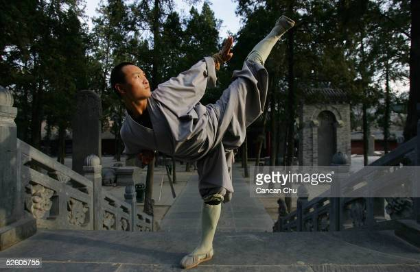 Warrior monk of Shaolin Temple displays his Kung Fu skills outside of the temple April 6, 2005 in Dengfeng, Henan Province, China. Shaolin Temple,...